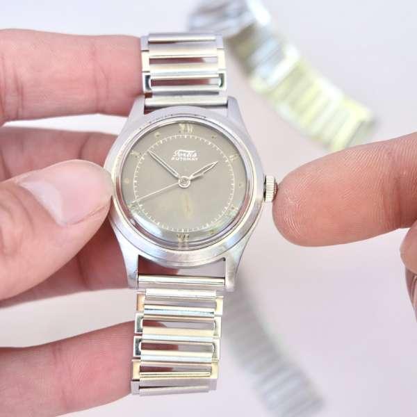 Montre bracelet acier mécanique histoire