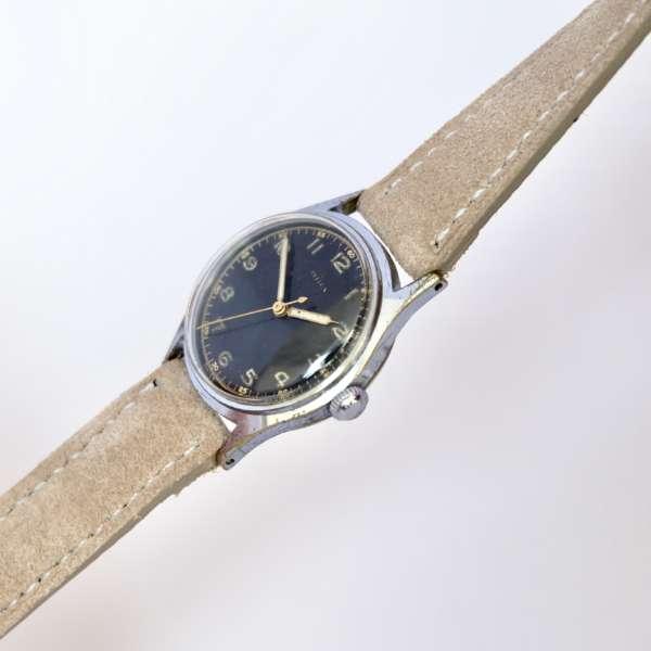 Montre bracelet beige vintage