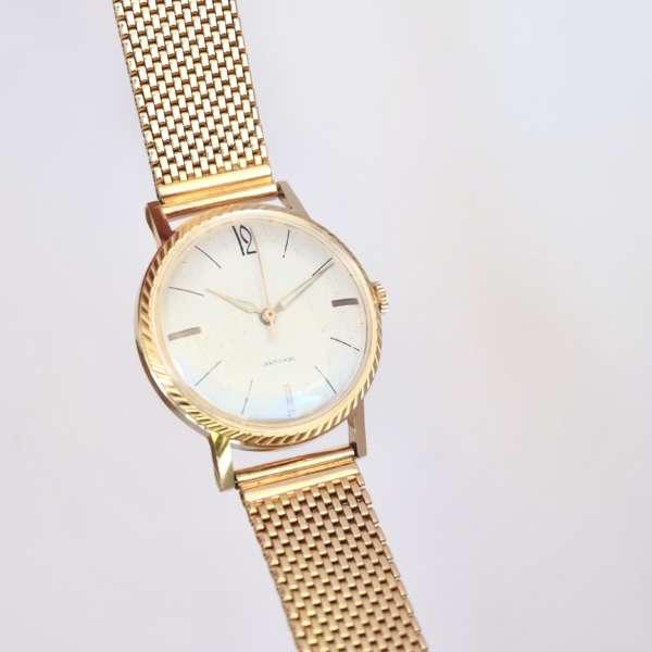 Montre vintage bracelet or